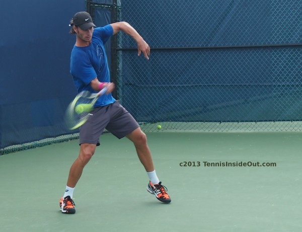 Christian Groh marionette pose funky forehand contact with tennis ball pictures