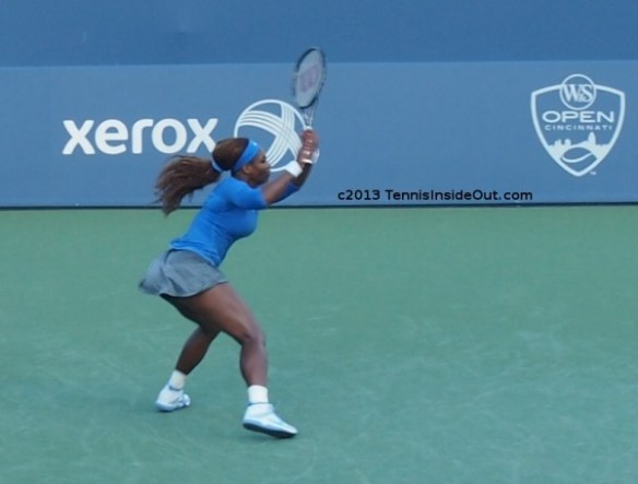 Serena Williams backhand winner racquet flying hair strong legs Cincinnati US Open series USO pictures photos long sleeve shirt sweaty images pics