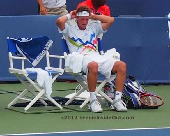 David Nalbandian adjusting headband sitting down on changeover break