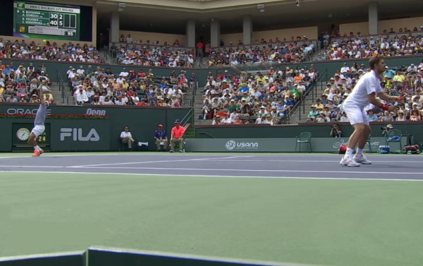 Roger Federer Stan Wawrinka serve and volley service motion poised at net Indian Wells BNP Paribas Open 2014 pics