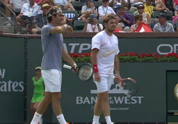IW 2014 Stan and Rog doubles Fedrinka chatting smiles grinning between points photos