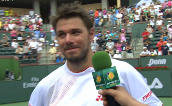 Stan exchanges look with Roger Federer doubles match photos pictures fluffy hair smile