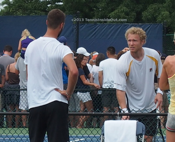 Benoit Paire hand on hip Dmitry Tursunov perplexed surprised look white Fila shirt joking pictures photos