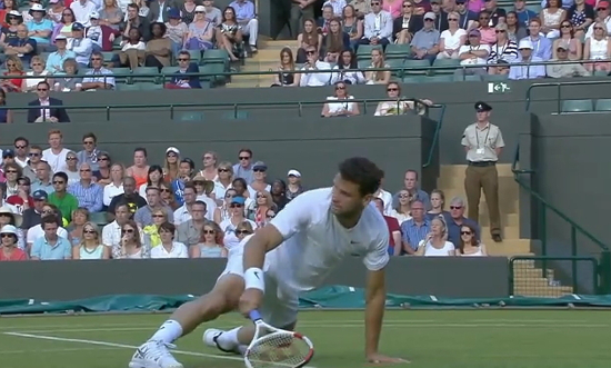Grigor Dimitrov falling on grass ground Wimbledon week one all white kit 2014