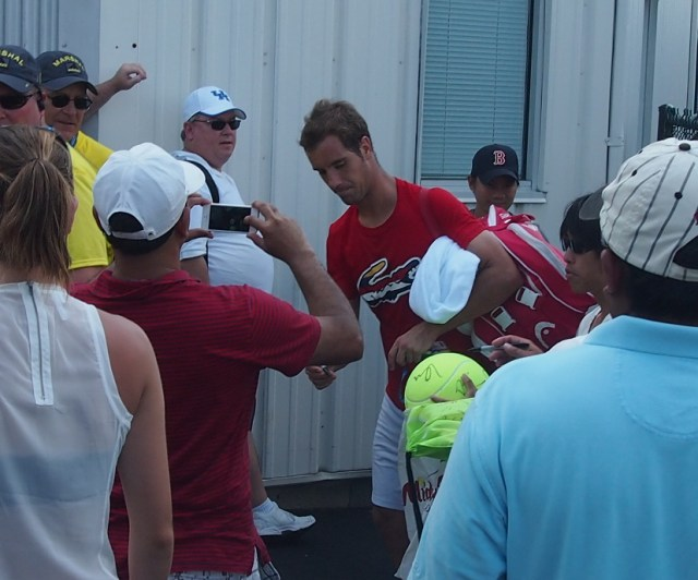 Richard Gasquet after practice 2014 Cincinnati signing autographs red Lacoste shirt