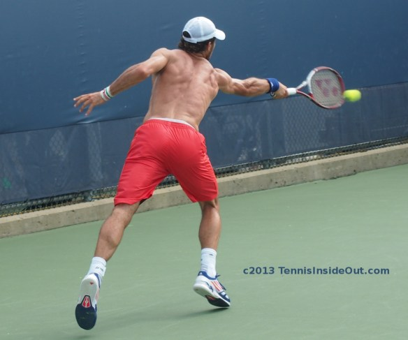 Juan Monaco shirtless naked back tight red shorts sweaty muscles shoulders biceps stretch backhand practice with Stan Wawrinka Cincinnati Open 2013 photos