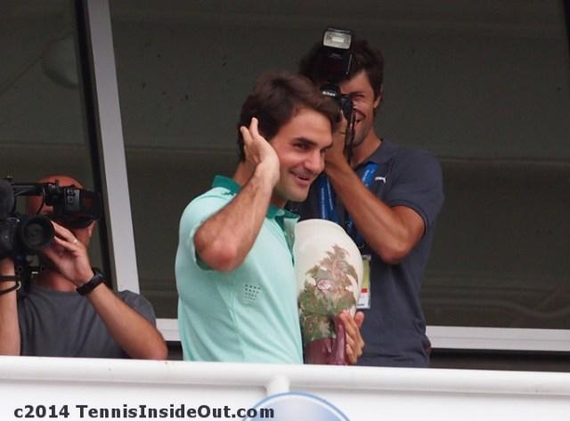 Roger Federer goofing off champions balcony