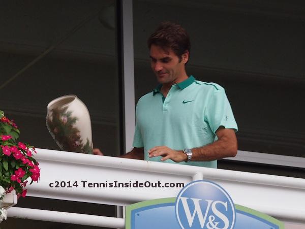 Roger Federer trophy champions balcony