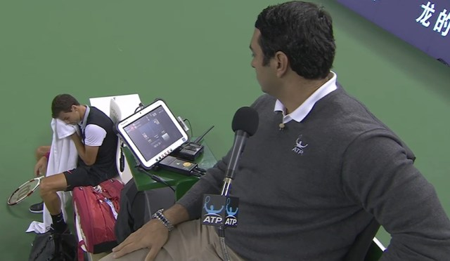 umpire Ali Nili China Grisha Dimitrov changeover toweling face