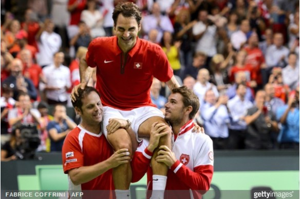 Davis Cup Severen Luthi Stan Wawrinka carry Roger Federer on their shoulders Davis Cup victory 2014 Italy