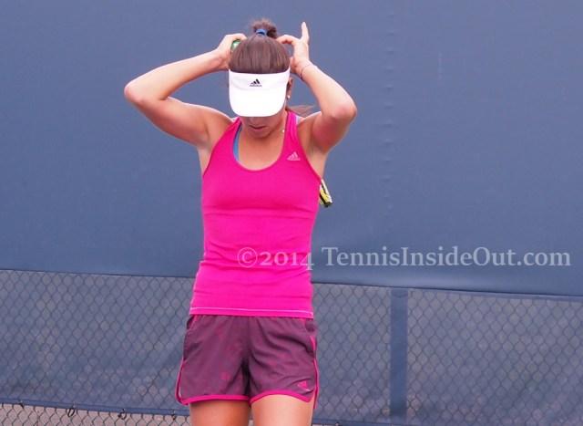 Ana Ivanovic fixing hair braid  hot pink purple outfit Cincinnati Premier tennis event photos pics images