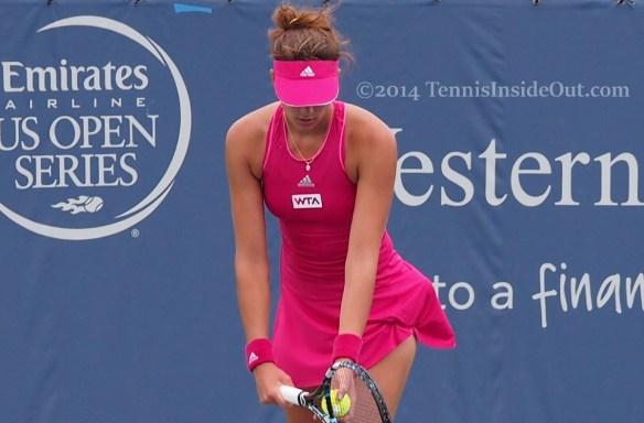 Pretty tennis players sexy Garbine Muguruza ready to serve tennis ball racquet pink dress visor Cincinnati 2014 pics