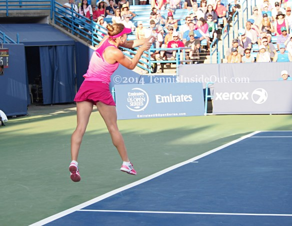 Leaping backhand pink dress Simona Halep Cincy 2014