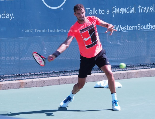 red Nike shirt Grigor Dimitrov black shorts big forehand swing