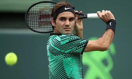 Federer keeps his momentum going