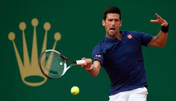 Djokovic squeezes through
