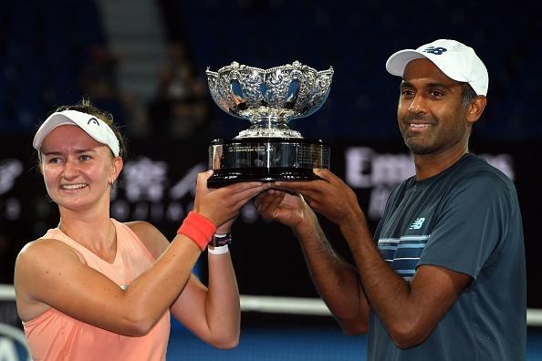 Melbourne   Krejcikova and Ram lift Mixed Doubles trophy