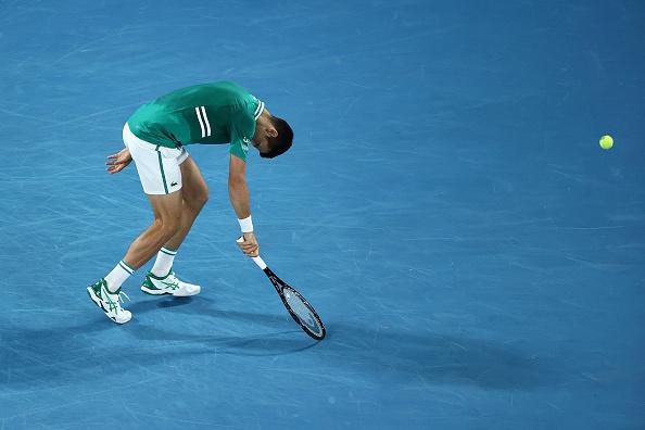 Djokovic staggers into semi-finals