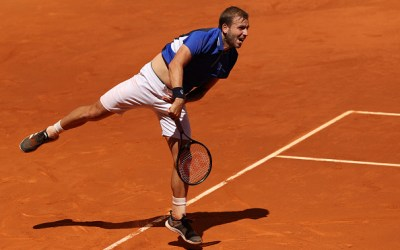 Evans reaches Madrid last 16; Nadal provides masterclass