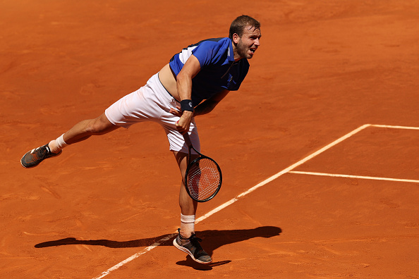 Evans reaches Madrid last 16; Nadal provides masterclass