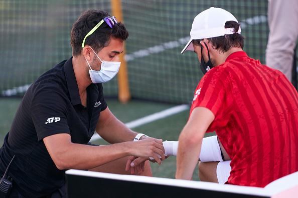 Thiem injured as Lopez reaches career milestone