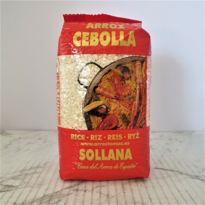 One full packet of paella rice on plain white background