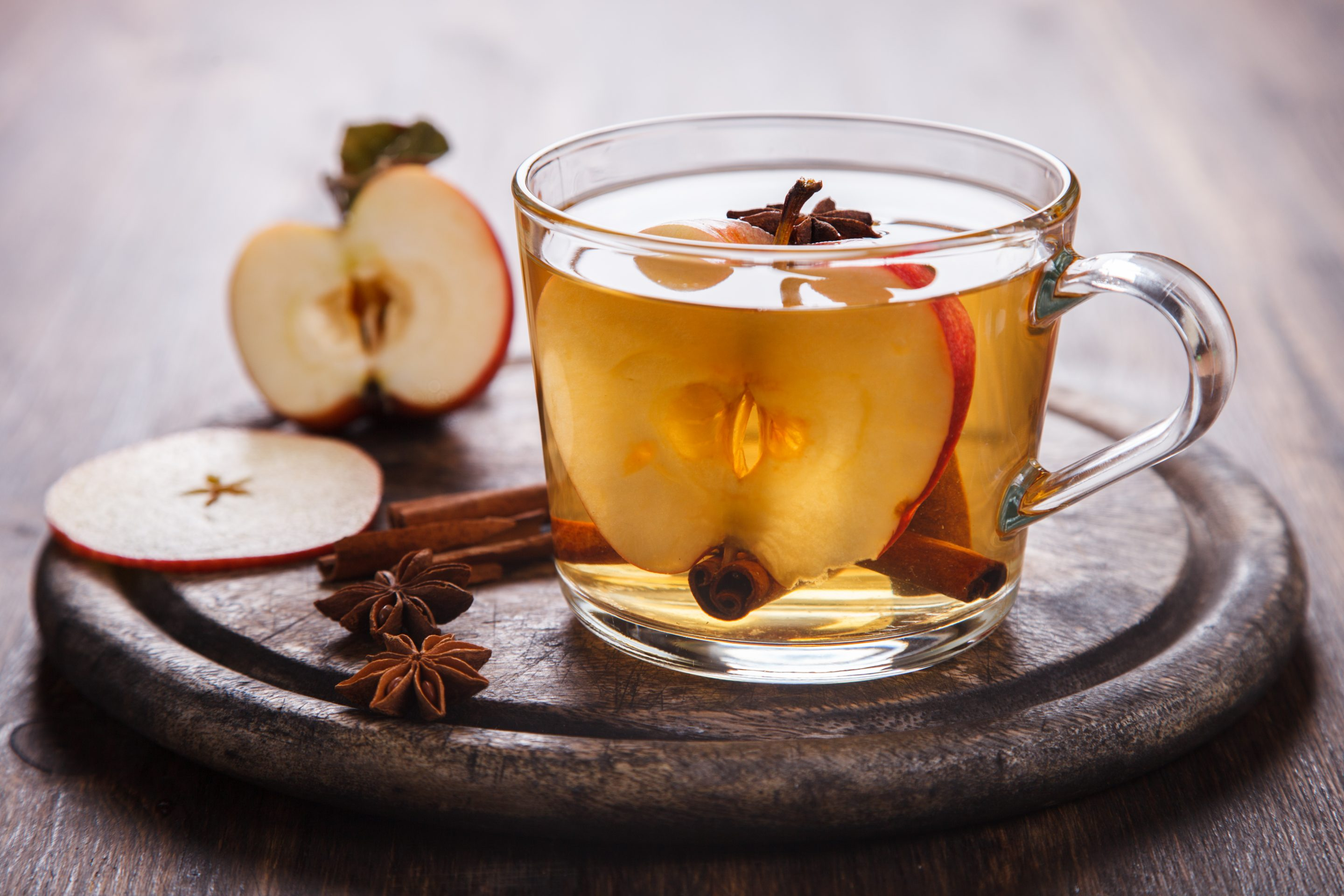 Single cup of apple tea with apple slices