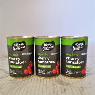 Three unopened tins of cherry tomatoes