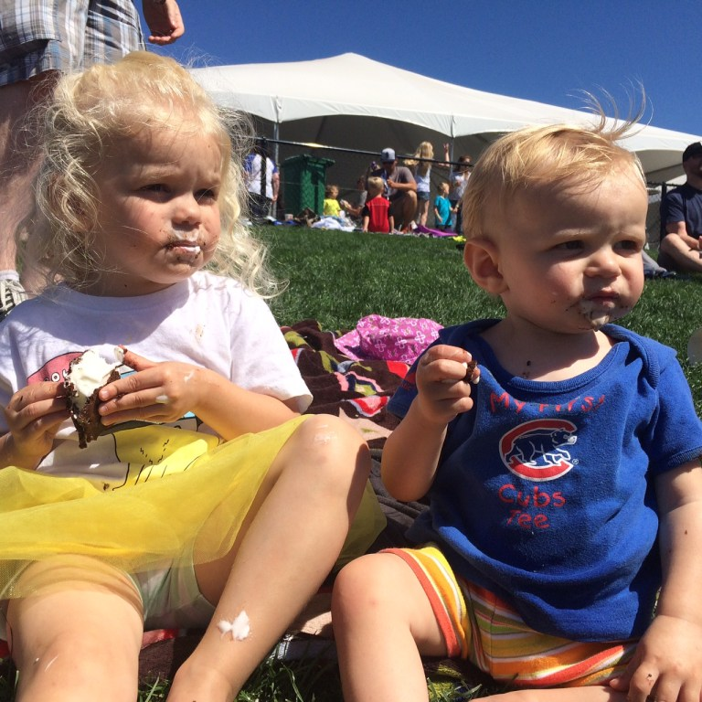Ice cream sandwiches at the baseball game: special treats for these sisters. Ten Thousand Hour Mama