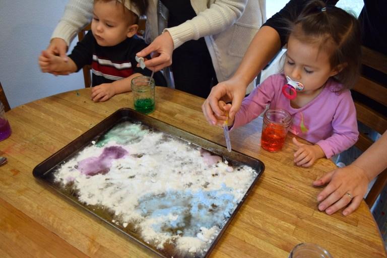 Homeschool preschool science experiment with baking soda, vinegar and watercolors. Ten Thousand Hour Mama