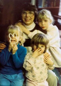 Grandma, my sisters and me (far left): Clearly, I was excited about baking cookies.