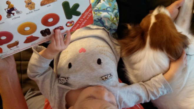 Reading and dog cuddles - Ten Thousand Hour Mama