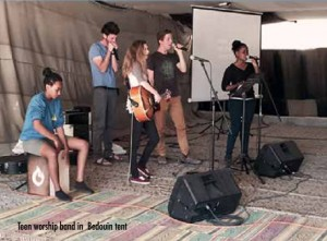 Teen worship band in Bedouin tent