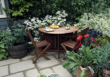 Patio with containers and table and chairs