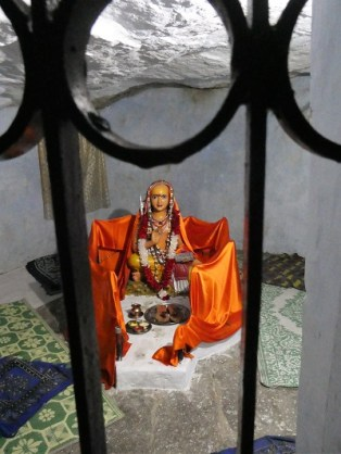 Statue in the cave under the 2000 year old Mulberry tree - where Sri Adishankaracharya meditated - Joshimath, Himalayan India