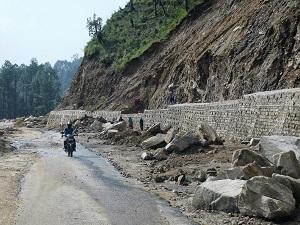 Creating rock retaining walls on the road to Gwaldam, Himalayan India