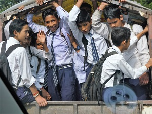 School boys in the back of a small bus near Nanital, Himalayan India