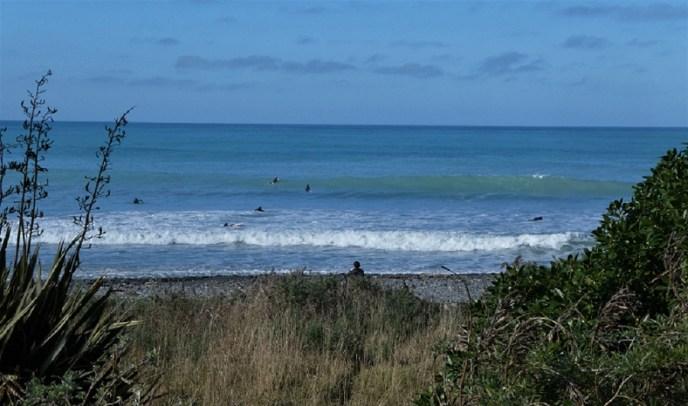 Surfers on the coast north of Kaikoura