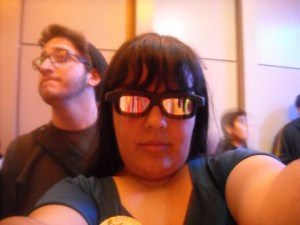 Rocking my extremely stylish Star Tours flight glasses. I love how the dude behind me is trying to not be photographed. :) GOTCHA ANYWAY!