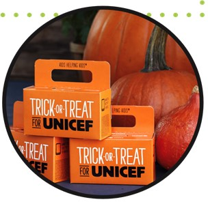 photo of Trick-or-Treat For UNICEF boxes with pumpkins in the background