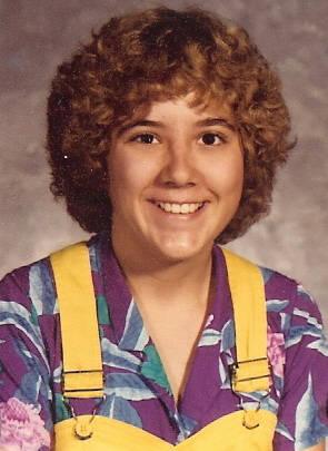 photo of the author in 1982 wearing a purple Hawaiian shirt and yellow overalls