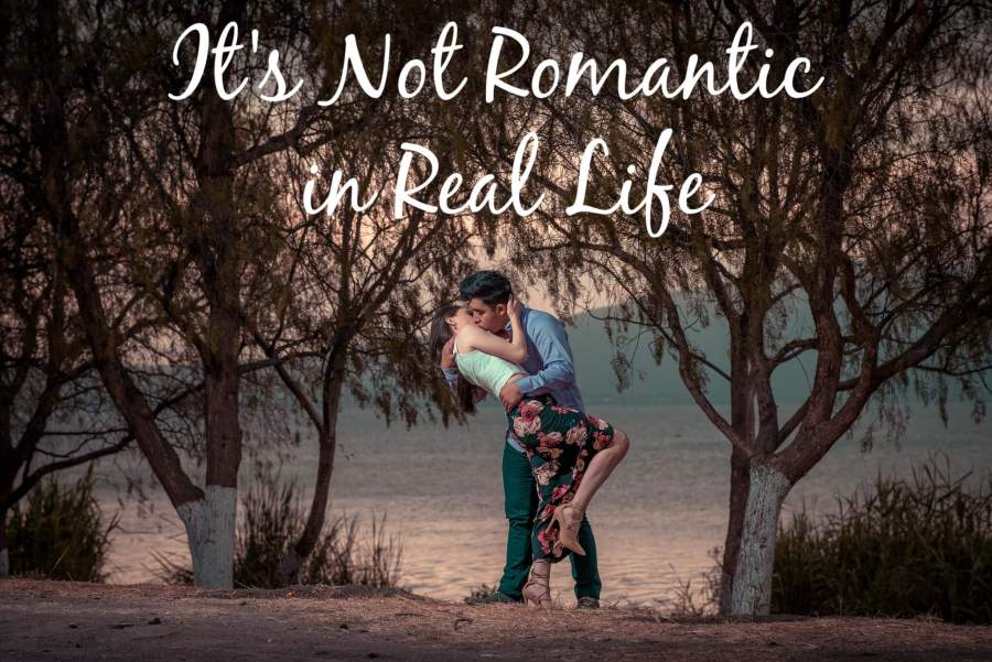 "A man and woman kissing passionately under the title ""It's Not Romantic in Real Life"""