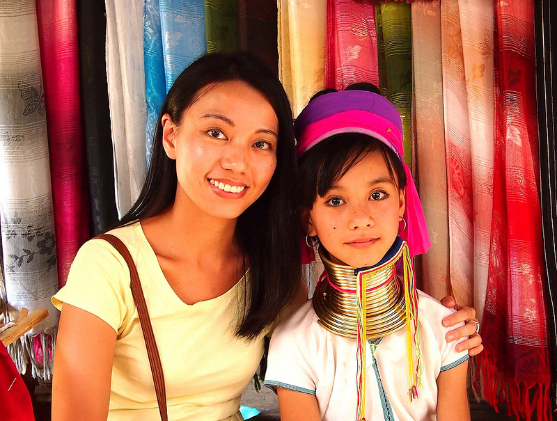 A Thai woman and child. The child wears brass rings around her neck