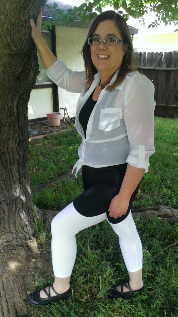 photo of the author wearing Lysse capri leggings with a black dress and white tie over blouse