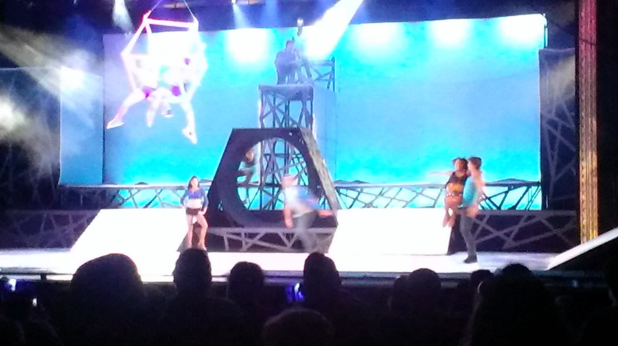 aerial artists and ice skaters performing on stage