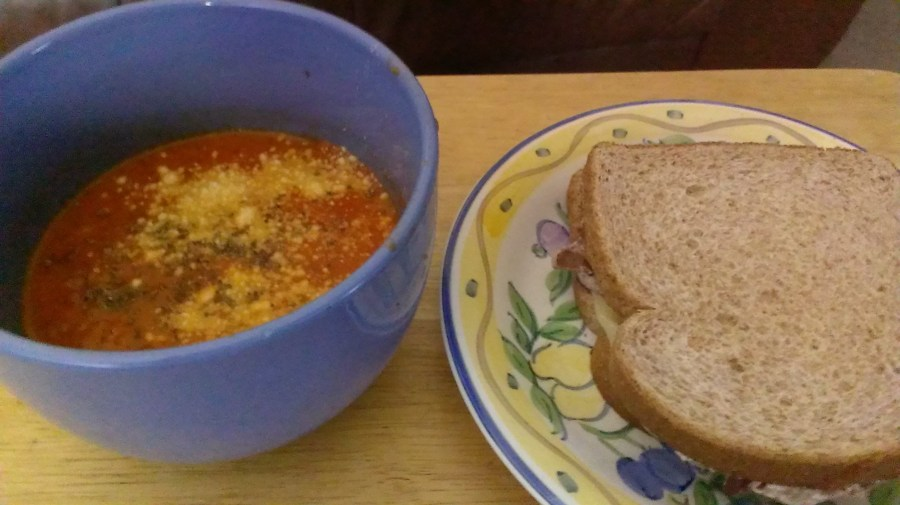 roasted tomato herb soup with a toasted cheese sandwich