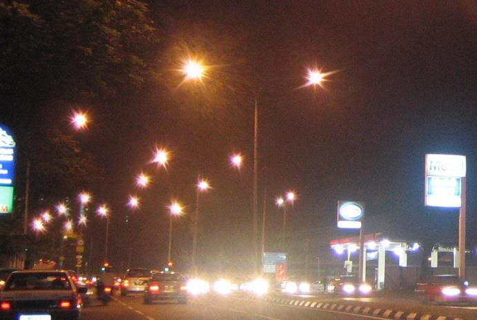 photo of a busy street at night, with lights appearing blurry