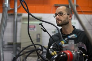 Josh Tibbitts helped to establish an OSU-Cascades lab for testing engines that compress and store natural gas. (Photo: Steve Gardener)