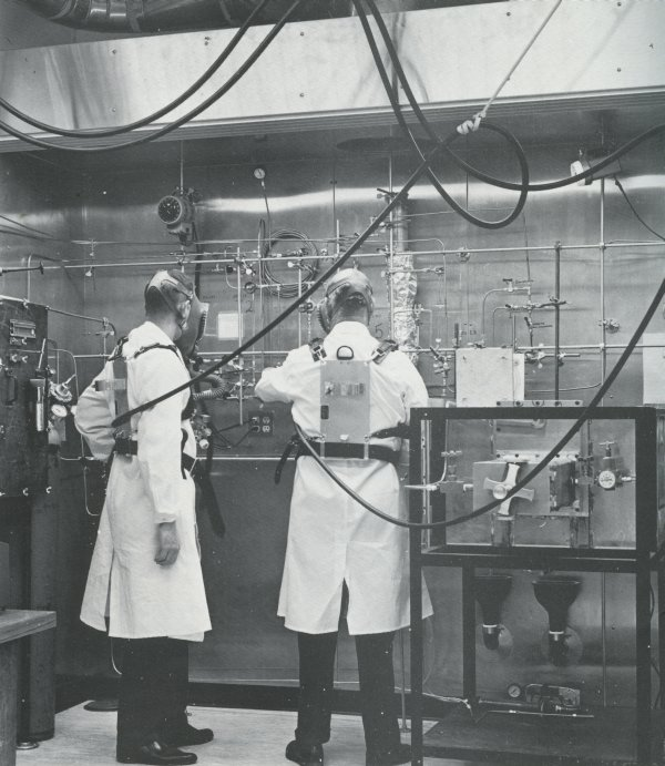 "Image from a booklet titled: ""The Radiation Center, Oregon State University,"" published by the State Board of Higher Education. Photo caption reads: ""Walk-in hood in a high-level radiochemical laboratory. One-pass ventilation system is used throughout the building. Hood exhausts are all equipped with absolute filters."" (Photo courtesy of the Special Collections and Archives Research Center)"