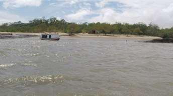 Barcos de pescadores são comuns às margens do Delta